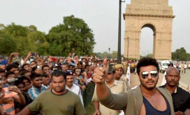 Bollywood actor Arjun Kapoor gestures at an awareness campaign for road safety....