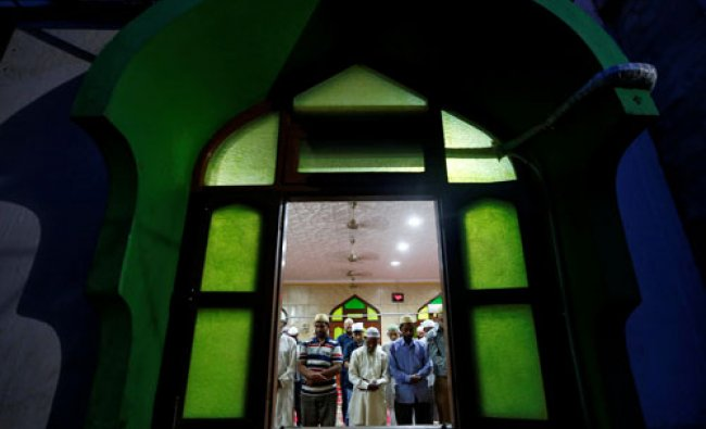 Muslims prays inside a mosque during the fasting month of Ramadan in Mumbai...