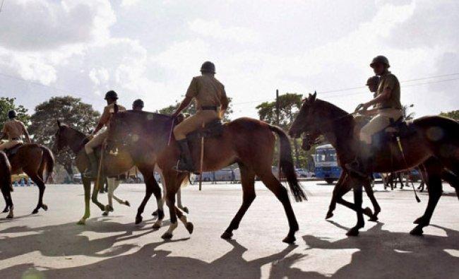 Horse-mounted Policemen seen at a road in Kolkata...
