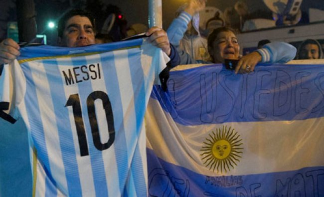 Fans holds an national soccer team jersey with the name and number of Lionel Messi...