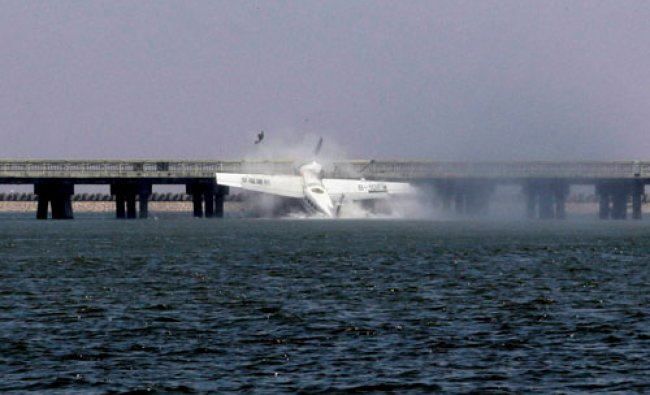 A seaplane hits the pier of a bridge in Shanghai, China...