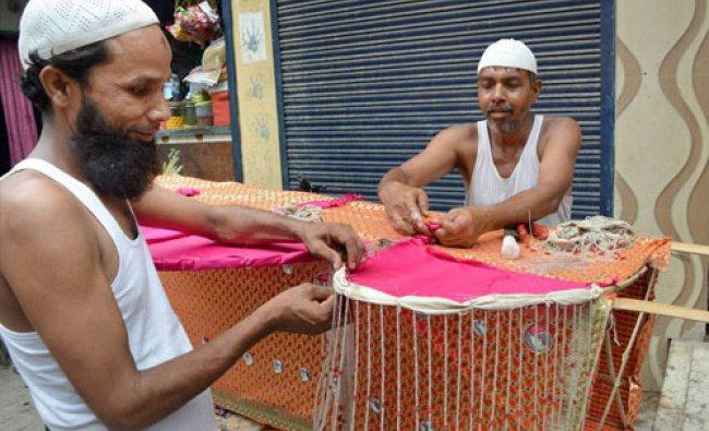 Muslims artisans preparing Kanwad for the holy month of Shravan in Meerut on Wednesday...