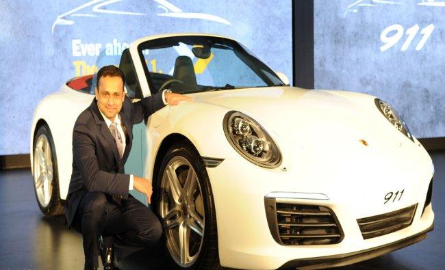 Director Porsche India oavan Shetty with new Porsche 911 car during the launch in Bengaluru...