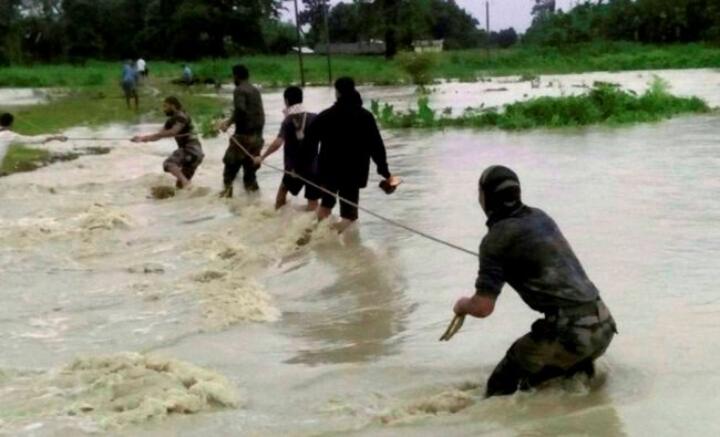 Indian Army soldiers rescue flood affected villagers near India-Bhutan border of Chirang...