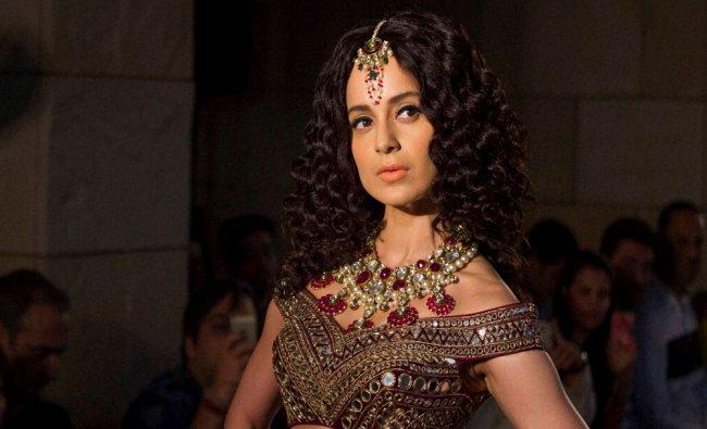 Bollywood actress Kangana Ranaut displays a creation by designer Manav...