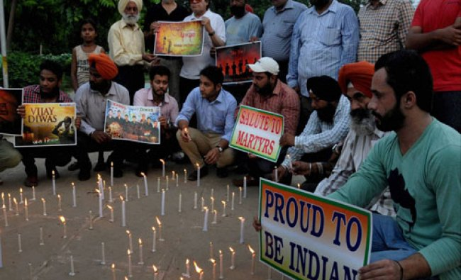 Members of National Human Rights and crime control organisation paying tributes to the soldiers ...