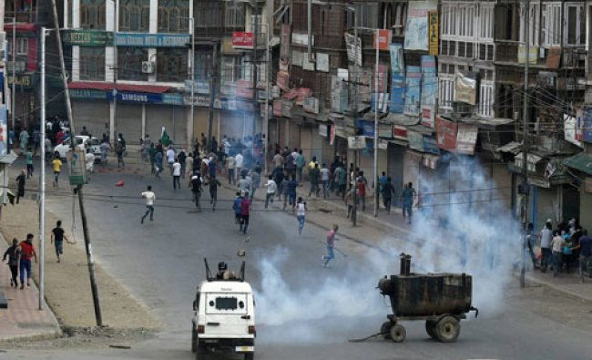 Police fire tear gas shells to disperse the rally, taken out from downtown city, on way to Lal ...