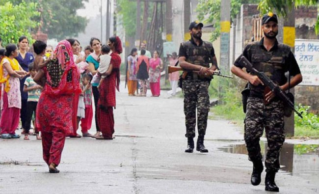 Punjab Police and BSF Jawans patrol after they captured suspected terrorists in Jalandhar\'s Khurla..
