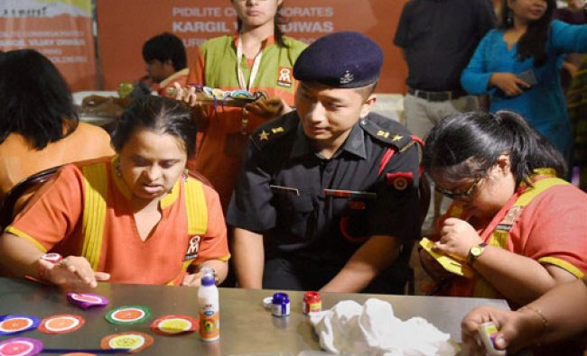 Specially abled kids from Om Creations Trust (NGO) make handcrafted rakhis as part of a campaign ...