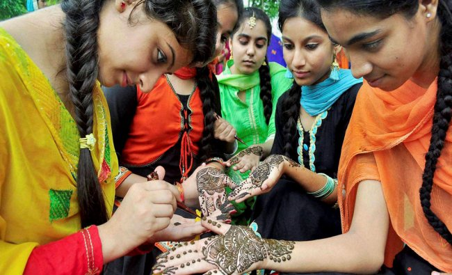 Girls applying Henna in a competition organised as part of the Teej Festival at a school...