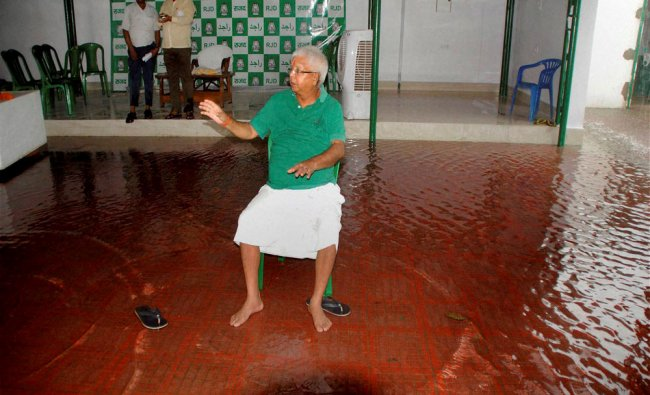 RJD Chief Lalu Prasad looking at his waterlogged residence after a press conference in Patna...