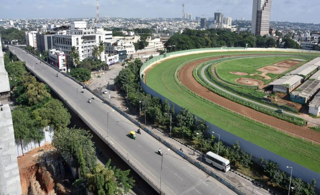 An deserted and aerial view of Anand Rao circle fly over on Sheshadri road following the bandh...