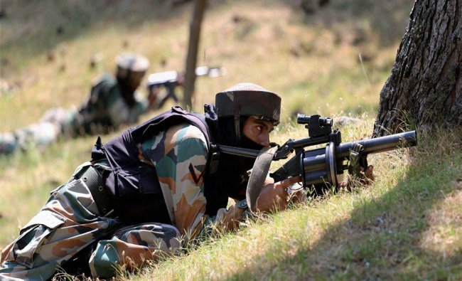 Army personnel take position at the site of encounter where two Army soldiers and two militants ...