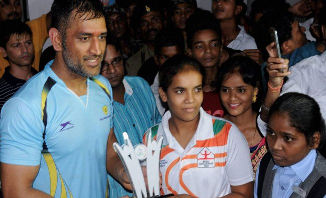 Dhoni felicitates Gold Medalists Indian Archer players during a programme...