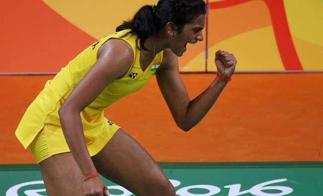 P.V. Sindhu (IND) of India reacts during her match against Wang Yihan...