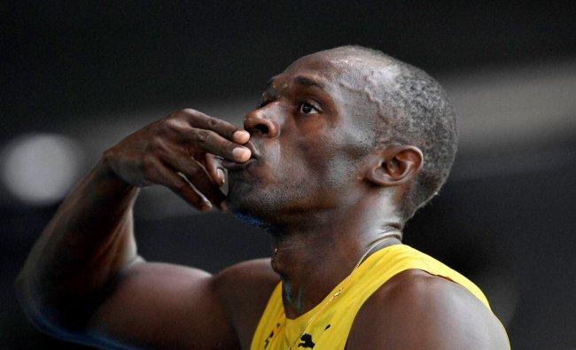 amaica\'s Usain Bolt celebrates winning the men\'s...