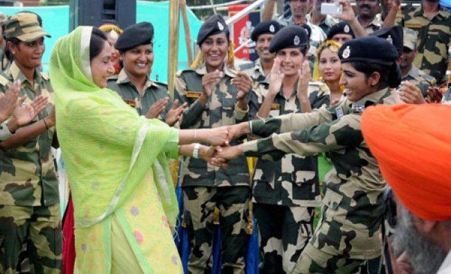 Union Minister of Food Processing Industries Harsimrat Kaur Badal celebrating Rakhi with BSF soldier