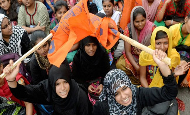 Students and ABVP activists shout slogans at a protest in Bengaluru on Wednesday demanding immediate