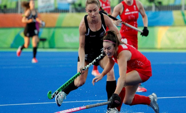 New Zealand\'s Anita McClaren, left, fights for the ball with Britain\'s Laura Unsworth during...