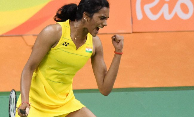 India\'s Sindhu Pusarla celebrate after defeating Japan\'s Nozomi Okuhara during a women\'s singles...