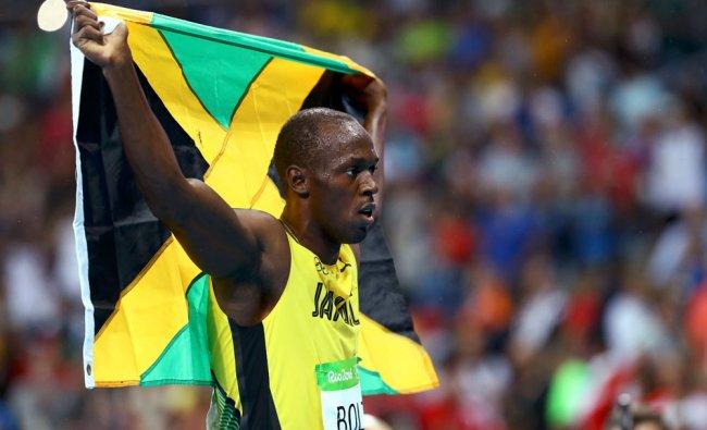 Usain Bolt (JAM) of Jamaica holds his....