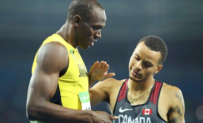 Gold medallist Usain Bolt (JAM) of Jamaica and silver...