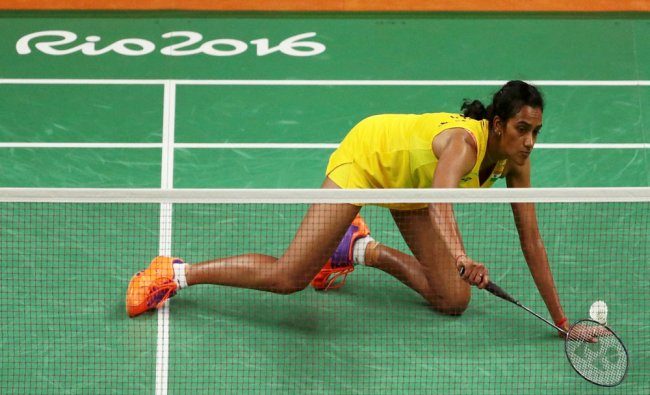 P.V. Sindhu (IND) of India goes on her knees to return a shot to Carolina Marin (ESP) of Spain...