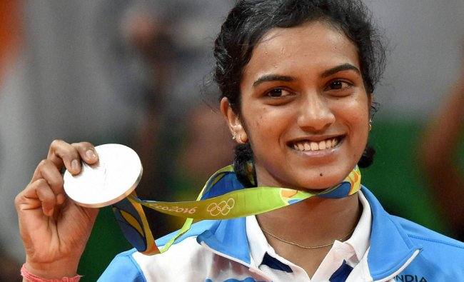 India\'s Pusarla V Sindhu poses with her silver medal after her match with Spain\'s Carolina...