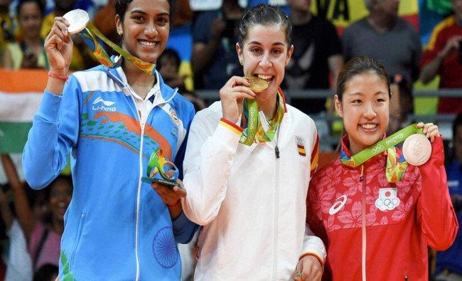(L-R) Silver medalist V. Sindhu Pusarla of India, gold medalist Carolina Marin of Spain...