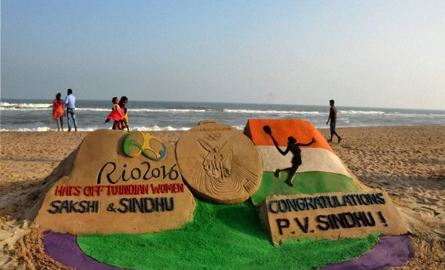 Sand artist Manas Sahoo creates a sand sculpture with message \'Hats off to Indian Women...