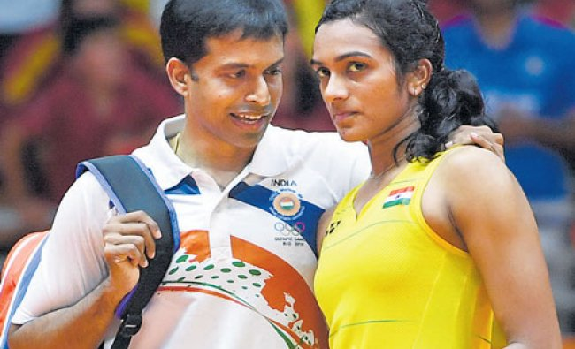 Coach P Gopichand (left) consoles his ward PV Sindhu following a heart-breaking loss...
