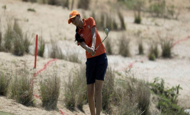 Aditi Ashok of India, hits to the green on the 2nd hole during the third round of the women\'s...