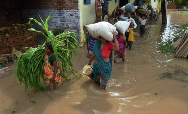 People shifting to safer places after their houses got submerged with flood water of river Ganga...