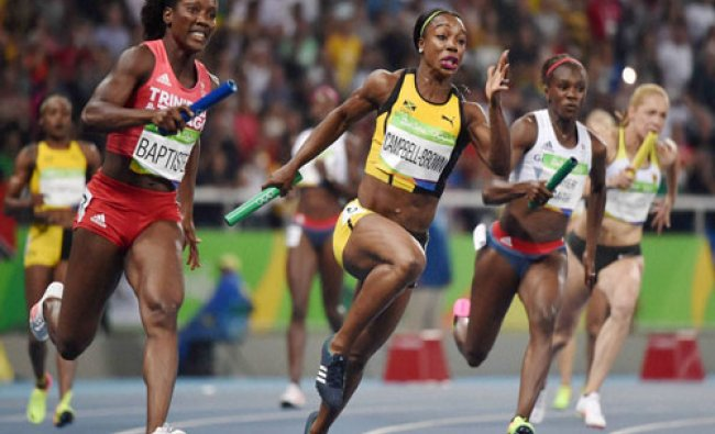 Women atheles in women 4x 100 meter Reley at the 2016 Summer Olympics at the Olympic stadium in ....