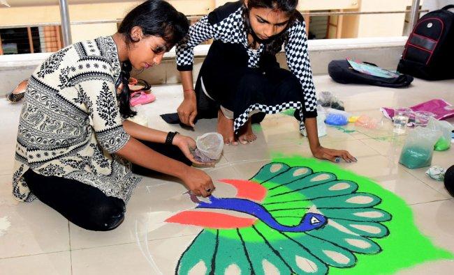 PUC and Degree students take part in District level Rangoli Competition at a Muggu at Laxmi...