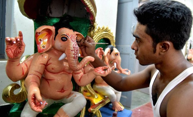 Bangla artist giving final touches to idols of Lord Ganesha ahead of Ganesh festival in Bikaner...