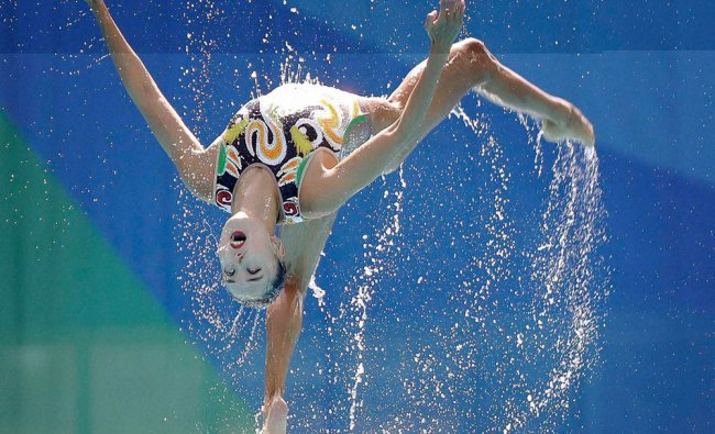 China\'s team compete during the synchronized swimming teams free routine final in the Maria Lenk ...