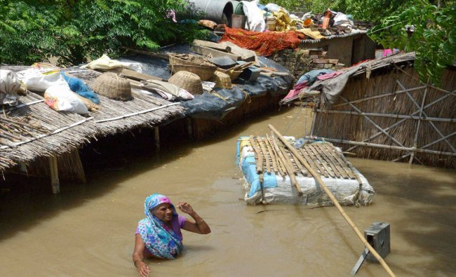 A woman waiting for help and relief in a flooded locality in Nakta Diyara, Patna...