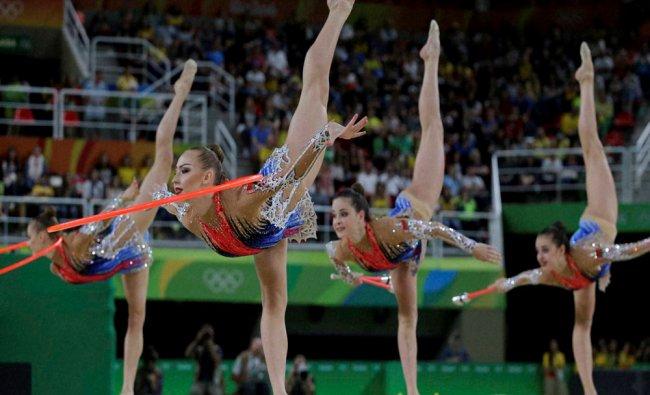 Team Belarus performs during the rhythmic gymnastics group all-around final...