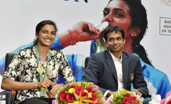Olympic Silver Medalist P.V.Sindhu along with her coach Pullela Gopichand addresses media...