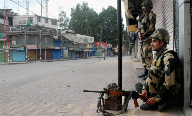 BSF jawans stand guard during curfew in Srinagar on Monday. The BSF has been deployed on law...