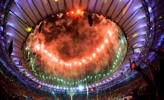 Pyrotechnics erupt during the closing ceremony in the Maracana stadium at the 2016 Summer...