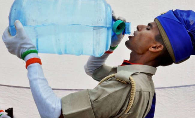 A newly inducted Provincial Armed Constabulary (PAC) personnel quenching his thirst...
