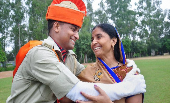 A PAC recruit of 23rd battalion jubilates with his mother after their passing out parade in...