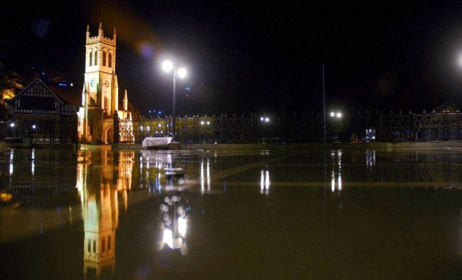 A view of historical ridge reflected in rain water after heavy rainfall in Shimla on Tuesday...