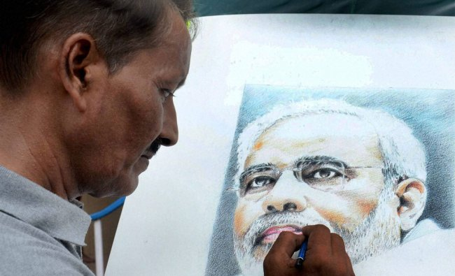 Renowned painter Partha Das gives final touch to a potrait of Prime Minister Narendra Modi...