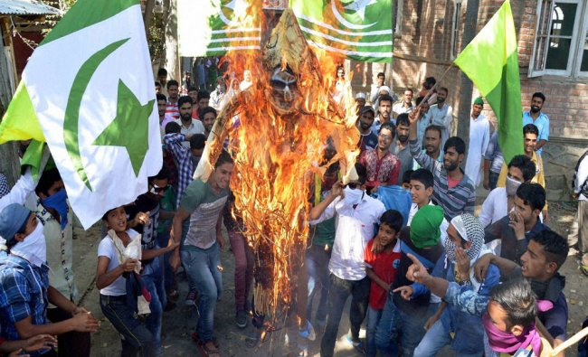 People burn the effigy of Chief Minister of Jammu and Kashmir Mehbooba Mufti...