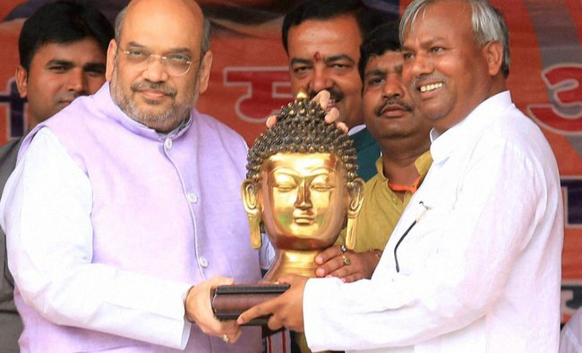Amit Shah is presented a memento at the \'Manavta Sadbhavana Samaroh\' in Lucknow...