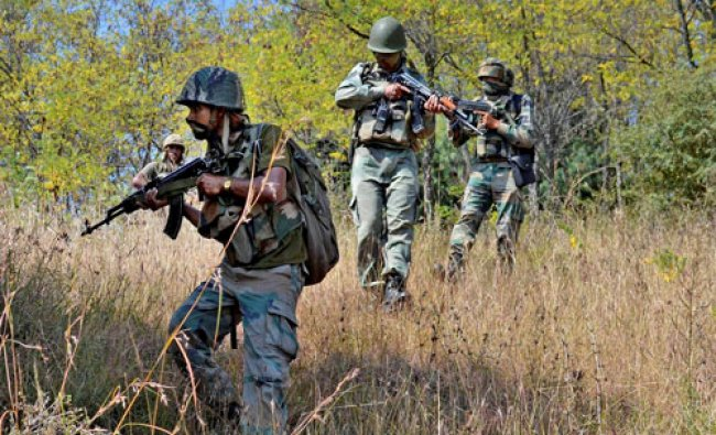 Army personnel take positions and moves towards the site where militants were hiding during...