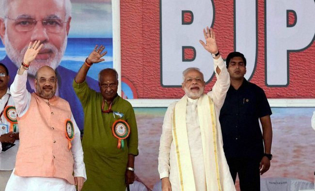 Prime Minister Narendra Modi with BJP President Amit Shah wave to the crowd at public rally...